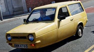 Top 10 worst cars - Reliant Robin yellow front quarter