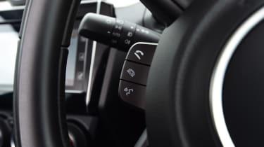 Suzuki Swift - steering wheel controls