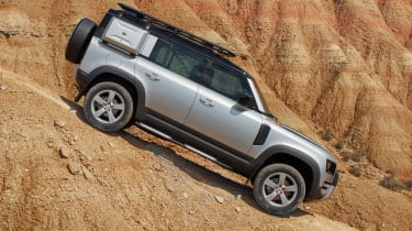 2019 Land Rover Defender in sand – side