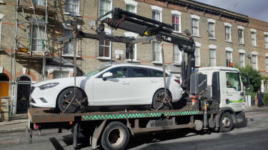 Foreign car clampdown - on truck