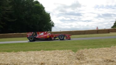 This is the 2010 Ferrari F10 screaming up the Goodwood hill - dirven by none other than Kimi Raikkonen.