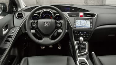 The Civic's dash is confusing to use and the satnav infotainment system looks like an aftermarket addition.