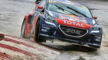Peugeot Sport - Sebastian Loeb front cornering