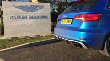 Audi RS3 outside Aston Martin HQ