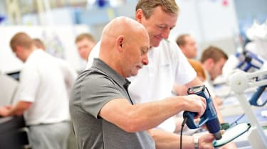 Our man Gibson gets some hands-on experience on the Bentley production line.