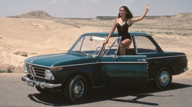 Model posing with BMW 02 Series