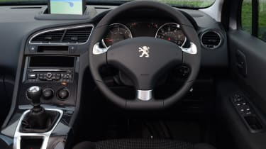The interior 'wraps around' the driver and leaves all the controls high-set and within easy reach.
