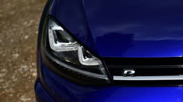 Subtle 'R' badges are dotted around the car to hint at the car's potential.