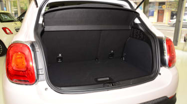 Rear seats fold to expand load capacity from 245 litres to 910 litres. Space-saver spare wheel is fitted under the boot floor