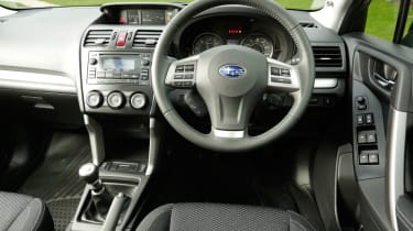 The Subaru Forester's interior is very solidly built but the design is dated and the plastics are hard.