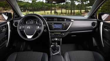 The Auris' interior is solidly built, but looks messy.