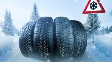 Winter tyres with snow warning sign