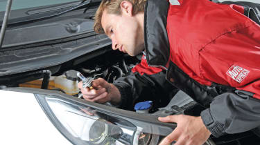 Headlamp bulbs are removed from the rear of the headlight. Access can be poor.