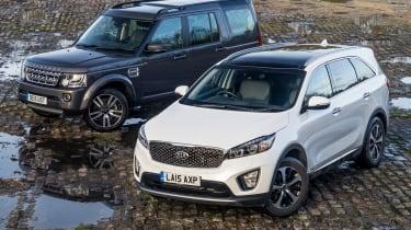 Used Range Rover Discovery 4 vs New Kia Sorento - front