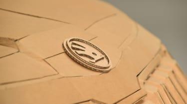 Cardboard Skoda Karoq bonnet badge