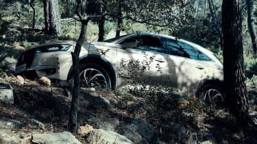 DS 7 Crossback E-Tense still hidden, but by tree trunks
