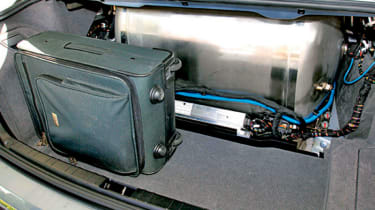 Gas tank takes up most of the space in vast boot. Button on wheel (below) allows driver to switch fuels.