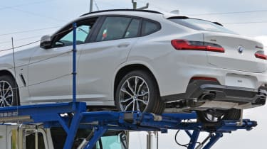 New BMW X4 spied uncovered rear quarter
