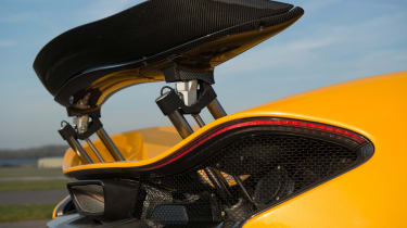 The rear wing rises when the car is in race mode to provide extra braking power and increased downforce.