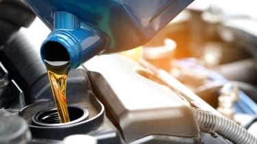 Oil being poured into an engine